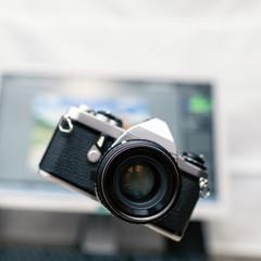 Camera, analog photography over new technology background