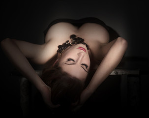 Beautiful girl lying on a table