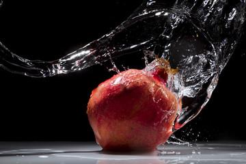 Pomegranate splashing water