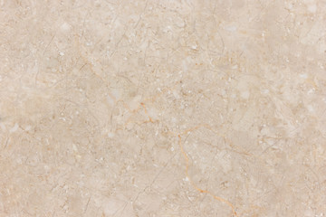Beige marble stone wall background with natural pattern.