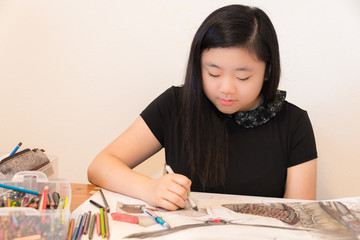 Portrait Young Asian Teenage Artist Drawing. Copy space.