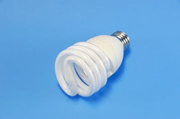fluorescent light bulb on blue background