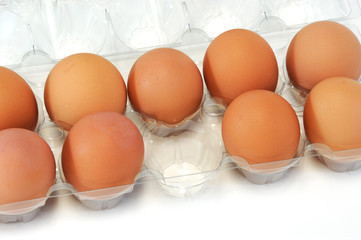 close-up on fresh eggs with one missing in container