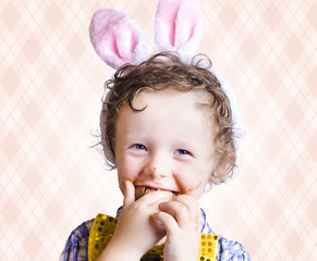 Child Eating Chocolate Easter Egg With Smile
