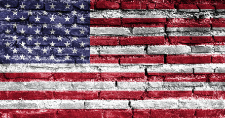 Painted USA flag on brick wall.