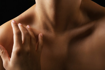 View on woman's neck, collarbone and shoulders, close-up