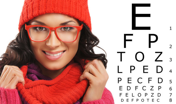 Beautiful woman with red scarf, hat and glasses over test vision