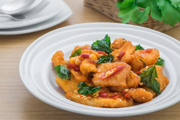 Spicy fried fish with basil (Pad kra prao pla), Thai food style