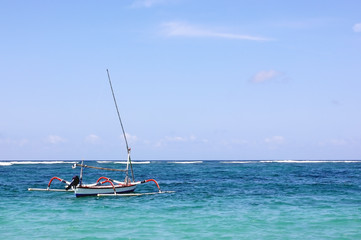 Traditional fishing boat in the blue sea