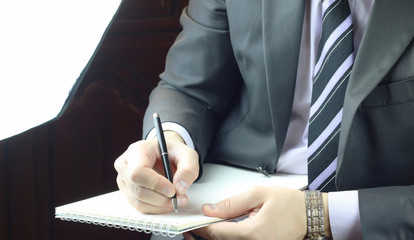 hand writing notes journalist