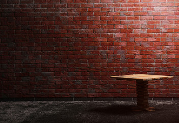 Small wooden table on red brick wall background