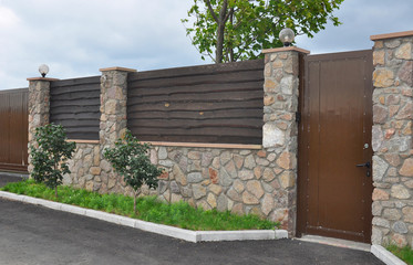 Stone and Metal Fence with Door of Modern Style Design Outdoor..