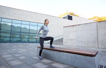 woman exercising on bench outdoors