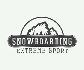 Vintage snowboarding logo, badge, emblem and design elements