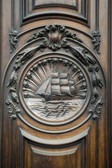 Architectural detail of an old wood door on the exterior of a traditional building in on the historical Avenida Rio Branco in Centro, Rio de Janeiro, Brazil