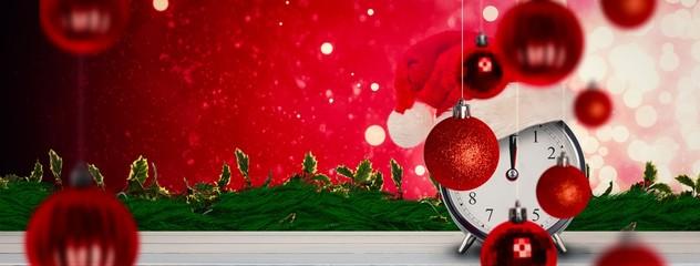 Composite image of christmas clock