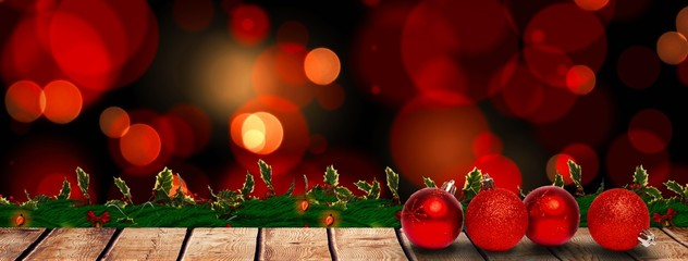 Composite image of four red christmas ball decorations