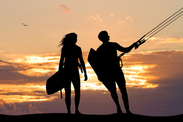 surfers couple at sunset