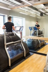 Injured athlete working out on treadmill