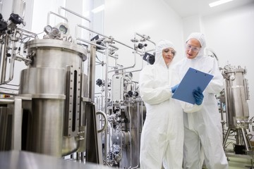 Scientists working with large vat