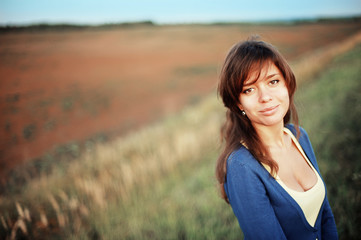 Portrait of a girl in field on  sunny day