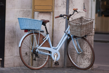 vintage bike with basket parked on the street