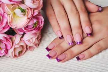 French nail art in purple colour