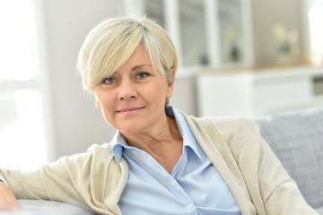 Portrait of senior woman relaxing in sofa