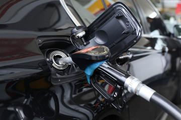 Pumping gasoline fuel in car