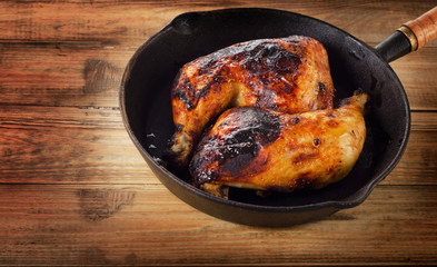 Roasted Chicken legs on a vintage cast iron skillet.