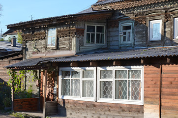 Old wooden house with carving in the city of Irkutsk