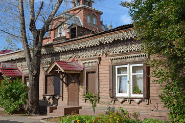 Wooden house with beauty carving and modern jalousie on Irkutsk street