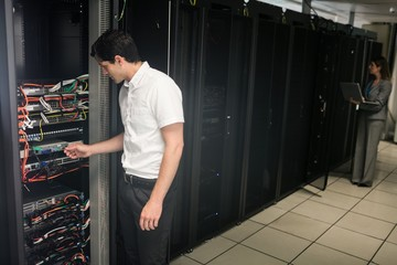Team of technicians working on servers