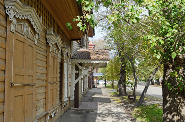 The wooden house with closed window shutters on Irkutsk street