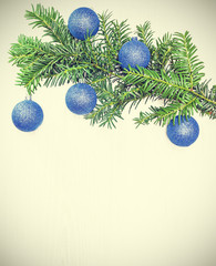 Retro toned Christmas decorations on a wooden board.