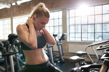 Woman resting after cycling workout in gym