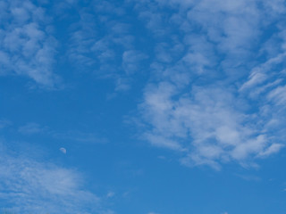 blue sky with fade moon