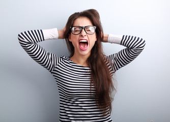 Anger young business woman in glasses strong screaming with wild