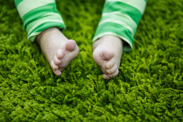 Legs of baby on the soft rug