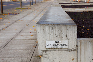 No Skateboarding Sign on Ledge
