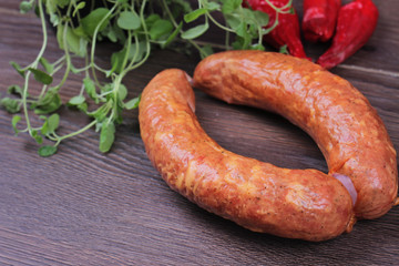 Raw homemade Kranjska sausages on wooden background