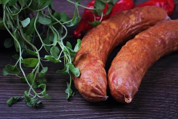 Raw homemade Kranjska sausages on wooden background