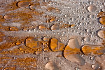 Water drop patterns on wood.