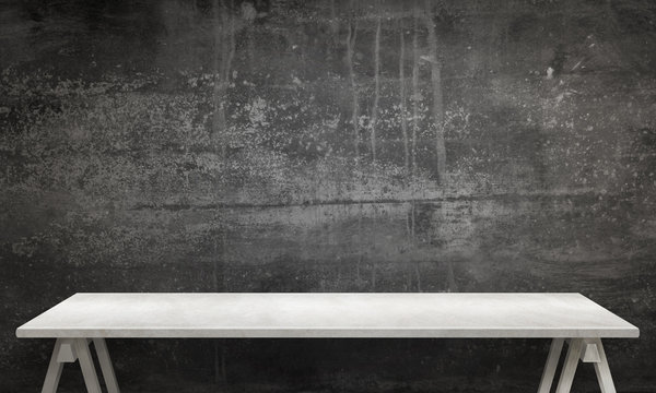 Modern white table with legs and free space. Black wall texture in background.