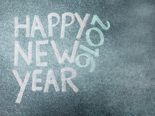 Happy new year 2016, hand writing with chalk on blackboard, vint