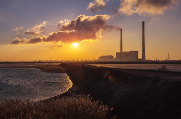 thermal power plant ash lagoon at sunrise