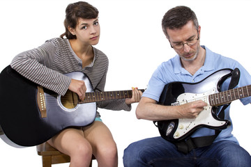 Female looking frustrated with male music instructor teaching how to play guitar