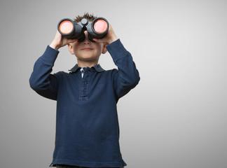 little kid using binoculars