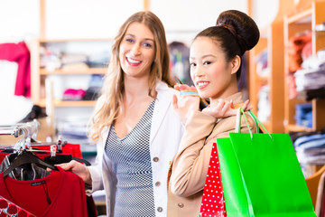 Women buying fashion in shop or store