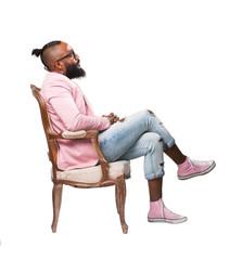 cool black man sitting on a sofa